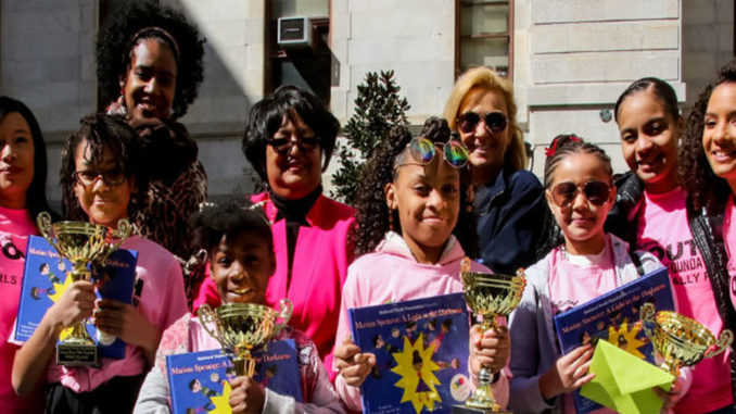 "In front, from left, are Winton Hill Academy students Serenity Mills, Aliyana O'Neal, Nakiyah Ray and Janyia New. In back, from left, are Sophia Hanson, National Youth Foundation co-founder; Nikki Maxwell, ""Dork Diaries"" illustrator; Rachel Renee Russell, ""Dork Diaries"" author; Julie Dellecave, Winton Hills Academy fourth-grade teacher; Jamee Joppy, NYF co-founder; and Carolyn Crawford, NYF co-founder. Photo provided"