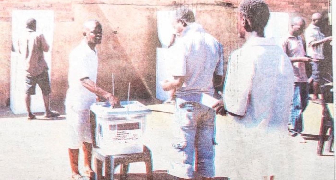 """""""Prisoners here in Malawi do vote,"""" said Augustine Suwedi Chidzanja, an election official in the Salima Central District, as an assistant observed that he didn't see a deterrent that would keep Americans in prison from returning to prison upon release because """"all their rights"""" have been taking away. (Photo: Kondwania Kamlyala)"""