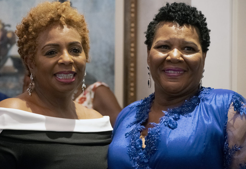 """Faith Morris of the National Civil Rights Museum greets Alice Marie Johnson, who also shared her """"freedom journey"""" during a presentation at the museum last Monday (June 3)."""