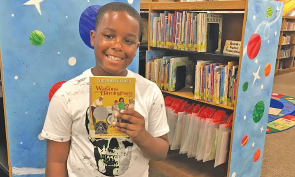 """Dalvin McCollum, 10, used his love of comics to create a newspaper, """"B'HAM NEWS,"""" that included an article, a drawing of the 16th Street Baptist Church, and a comic strip based on """"The Watsons Go to Birmingham 1963."""" (Photo by: Kathryn Sesser-Dorne 