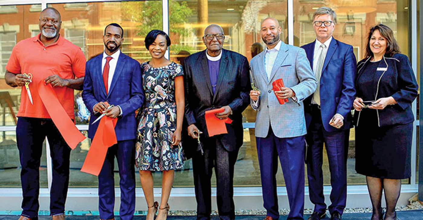 THE PARTNERSHIP—Those involved in the Miller Street development include state Rep. Jake Wheatley, Derrick and Nykia Tillman, Bishop James M. Foster, Pittsburgh Councilman R. Daniel Lavelle, Bob Meeder and Lisa Kelly. (Photo by Emmai Alaquiva)