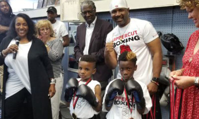 "Pictured from left to right: Thunder Robinson, Uppercut's owner, Marcus Pollock, executive director of Park Heights Renaissance, Coach Leon ""The Truth"" Wallace, Baltimore City Councilwoman Sharon Green-Middleton, in front are boxers Emmanuel Hibbert and Jalon Hall. (Courtesy Photo)"