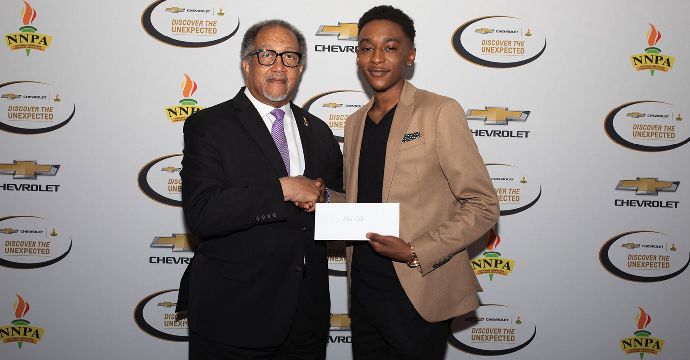Chevrolet Discover the Unexpected Fellow, Elae Hill (pictured right), is pictured with NNPA President and CEO, Dr. Benjamin F. Chavis Jr.