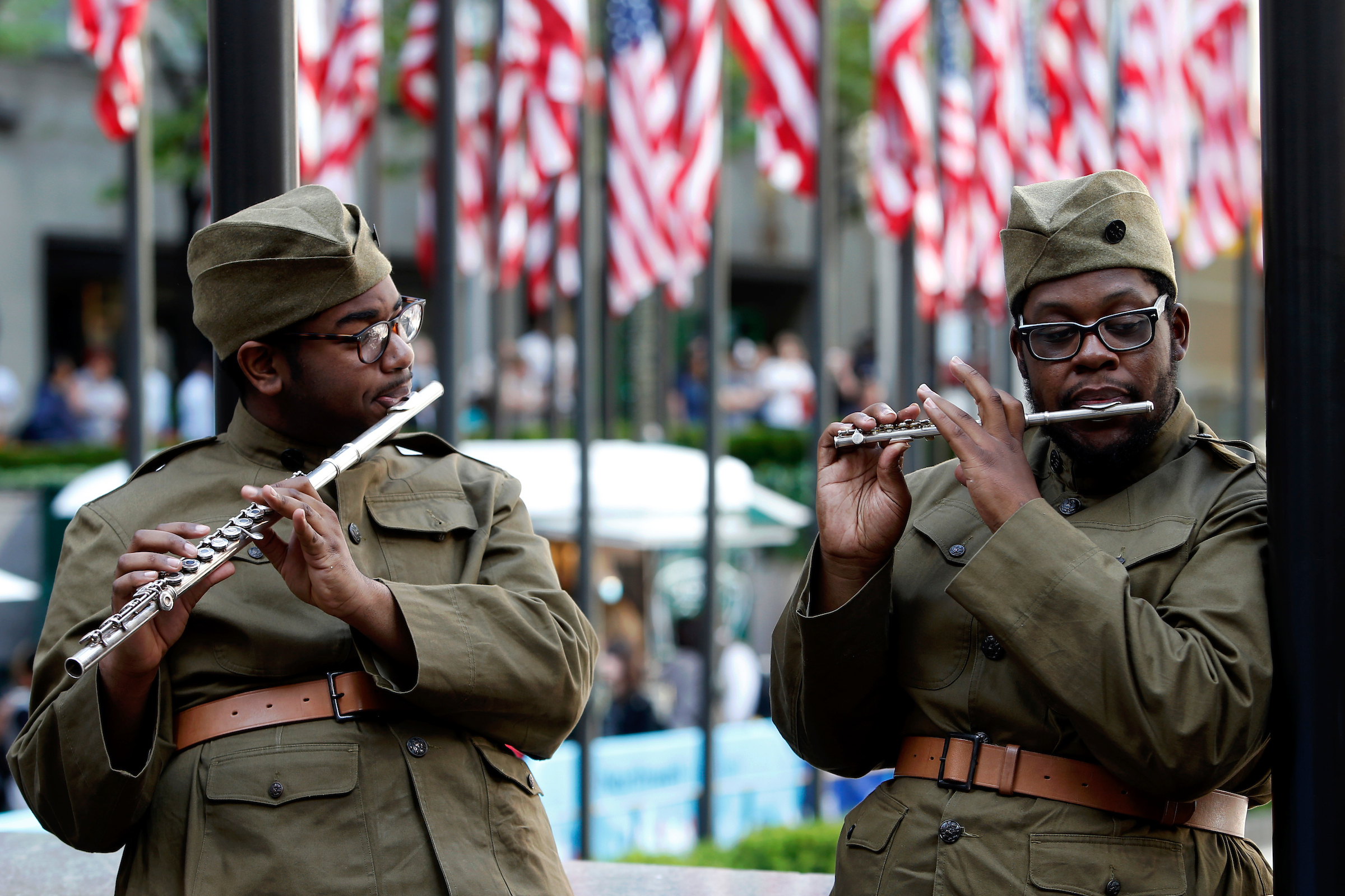 """The 369th Experience, a WWI tribute band sponsored by the U.S WWI Centennial Commission, performs in Rockefeller Center during Fleet Week New York, which this year is commemorating WWI, Saturday, May 25, 2019, in New York. The band, which is made up of music students from Historically Black Colleges and Universities across the U.S., play the musical repertoire of New York's legendary 369th Regiment """"Harlem Hellfighters"""" Regimental Jazz Band. (Jason DeCrow/AP Images for U.S. WWI Centennial Commission)"""