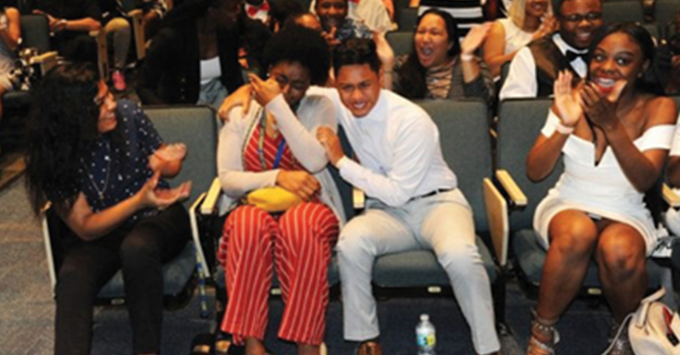 Janiyah Kennedy (L) and Alexander Castillo (R) break into tears as they learn that they have both been awarded a four-year, fully paid scholarship — each valued up to $30,000— from the Biscayne Bay Kiwanis Club.