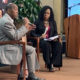 Houston Mayor Sylvester Turner with microphone sitting next to Harris County Judge Lina Hidalgo (Photo by: defendernetwork.com)