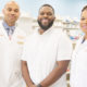 Customer Bernard Macon (center) is shown with Vincent and Lekeisha Williams, owners of LV Health and Wellness Pharmacy in Shiloh, Illinois.