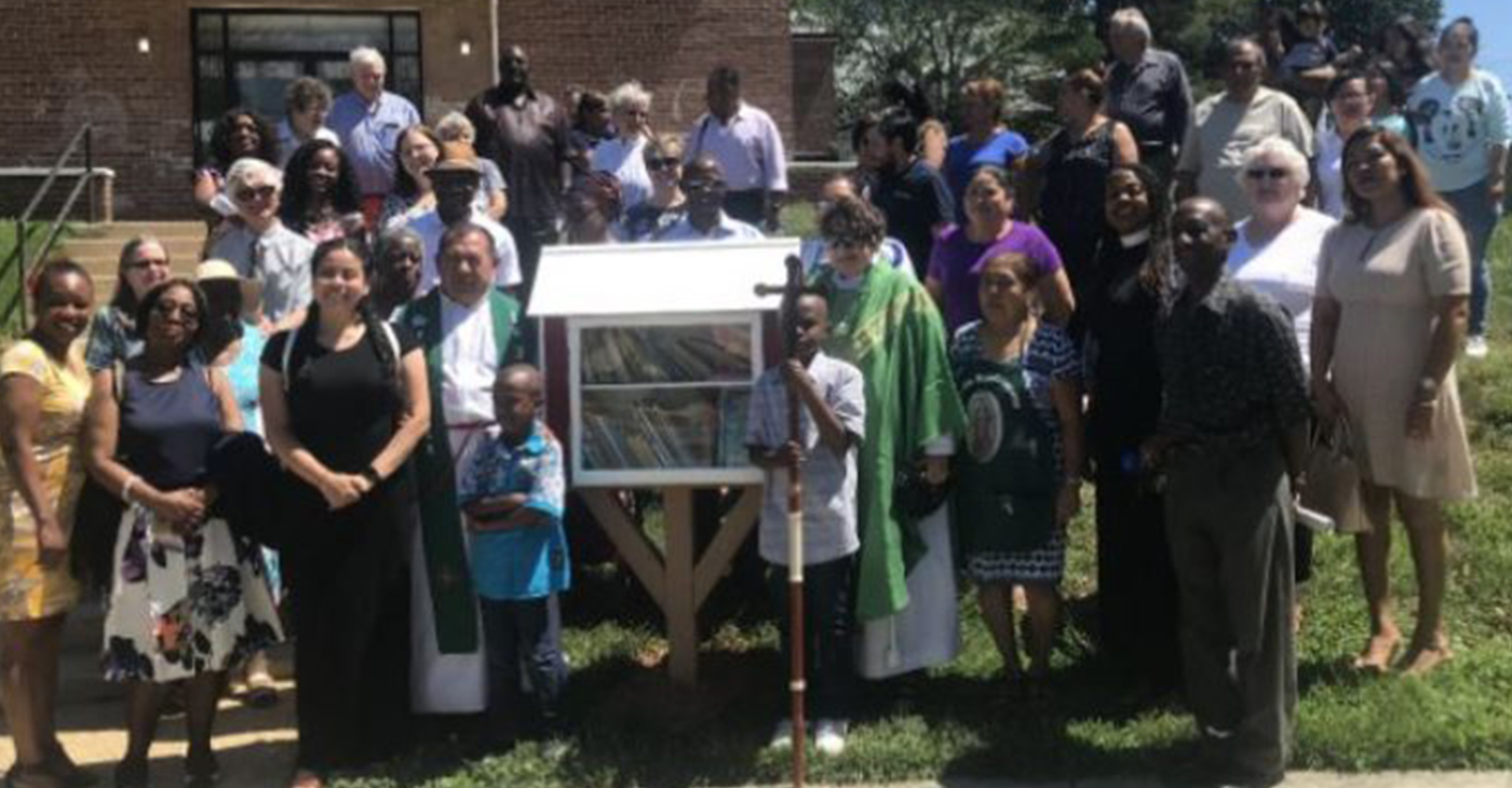 St. Matthew's Episcopal Church/ Iglesia Episcopal San Mateo in Hyattsville, MD. officially dedicated the first Little Library solely for children on June 30. (Photo by: Micha Green)