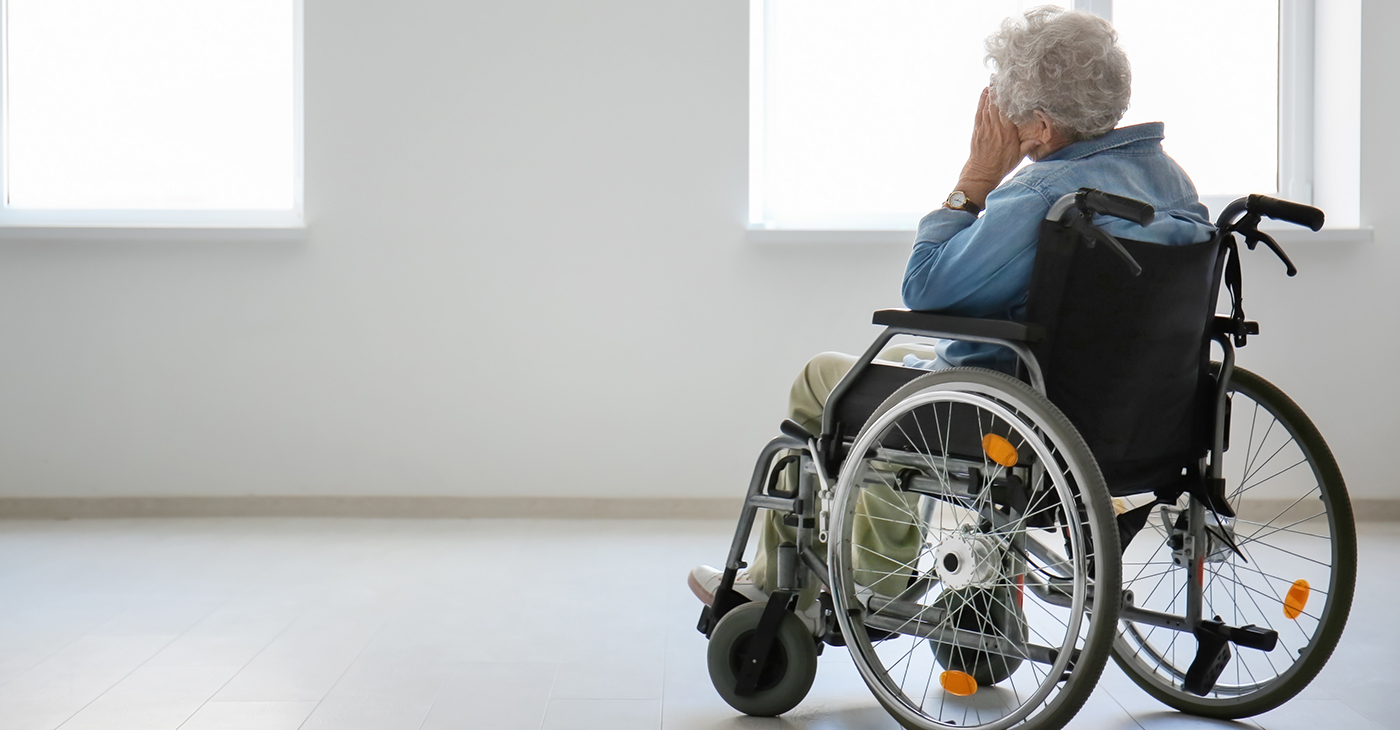 Lonely senior woman in wheelchair indoors (Photo by: Leonid | Adobe)