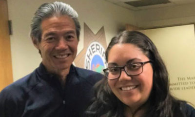 America Velasco (right) of the Sheriff's Office and Elmer Jan of the Marin County Free Library have teamed up to expand library selections for jail inmates.