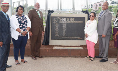 The Port Authority rededicated the Spirit of King plaque near the East Liberty Busway, June 19. Pictured are Edward Greene, Ashley Johnson, Malik Bankston, Gwendolyn Allen, Eric Wells, and Evelyn Newsome. (Photo by J.L. Martello)