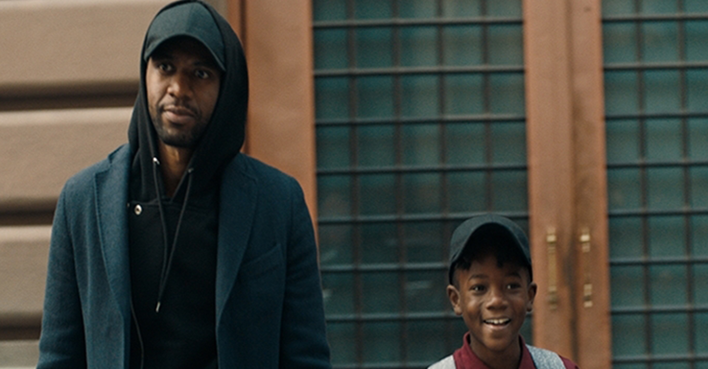 """""""The Look"""" follows a Black man throughout his day as he encounters a variety of 'looks' that symbolize a barrier to acceptance. In the film, the windows of a passing car are raised after his son waves to a young girl in the back seat. (Photo: Business Wire)"""