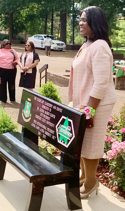 President Glenda Glover admires a commemorative bench dedicated in her honor by the AKA Sorority, Inc. Submitted Photo