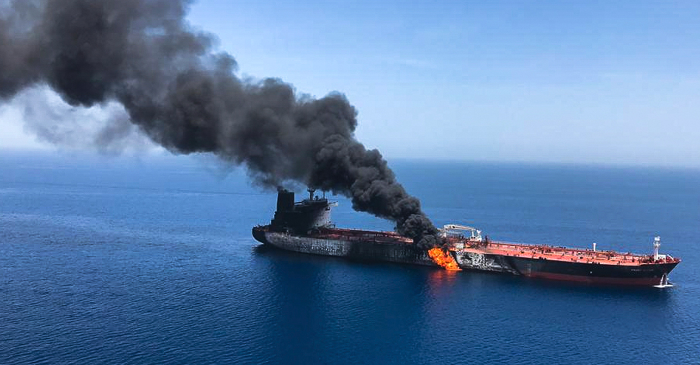 An oil tanker is on fire in the sea of Oman, June 13. Two oil tankers near the strategic Strait of Hormuz were reportedly attacked on June 13, an assault that left one ablaze and adrift as sailors were evacuated from both vessels and the U.S. Navy rushed to assist amid heightened tensions between Washington and Tehran. Photo: AP/Wide World Photo