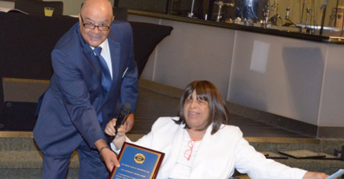 """Anita """"Ma"""" Vance receives the Pigskin Club Exceptional Community Service Award. (Photo by Maurice Pierce)"""